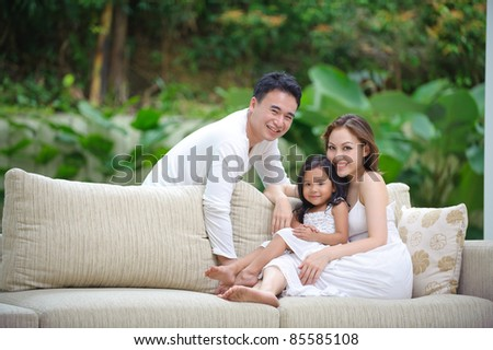 Asian Family enjoying time together in the living room - stock photo