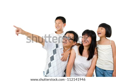 Asian family, father pointing to side over white background - stock photo