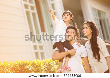 Asian family Happy Daughter pointing parents to look after her - stock photo