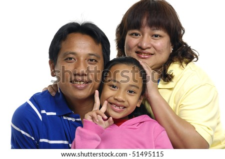 Asian family have a good time with their little daughter - stock photo