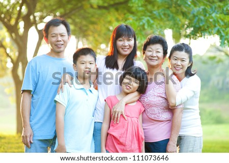 Asian family having a great time at outdoor park - stock photo