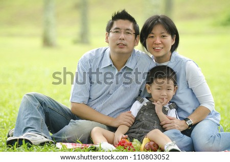 asian family having a picnic during outdoor ,focus on baby