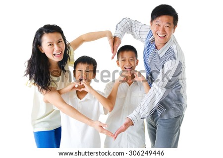 Asian family making heart shape with hands - stock photo
