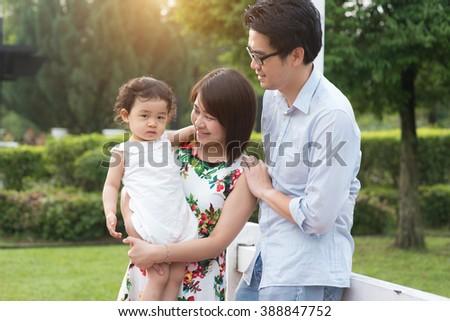 asian family outdoor - stock photo