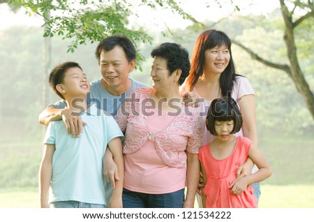 asian family outdoor enjoyment and quality time - stock photo