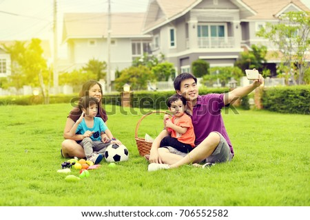 Asian family playing together in garden