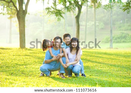 Asian family portrait at outdoor park - stock photo
