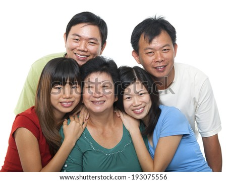 Asian family portrait. Happy senior mother and her adult offsprings, smiling isolated on white background. - stock photo