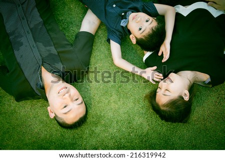 Asian Family portrait in sky garden outside - stock photo