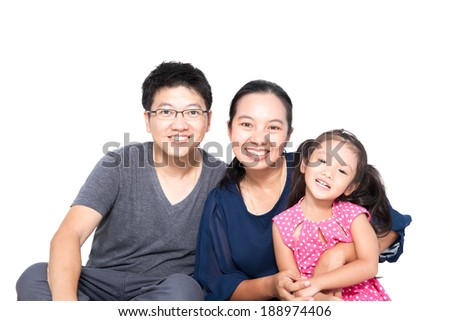Asian family posing on isolate white background