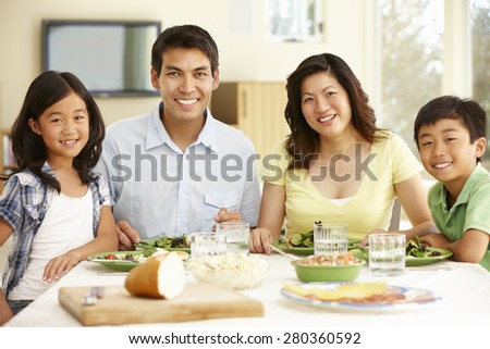 Asian family sharing meal at home - stock photo