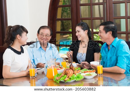 Asian family talking during the dinner - stock photo