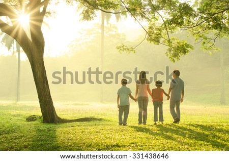 asian family walking outdoor in the morning - stock photo