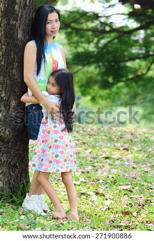 Asian family was happily in park - stock photo