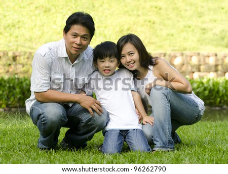 asian family with green background