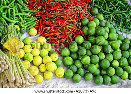 Asian farmer market selling fresh fruit and vegetables in Vietnam. Pepper, lemon, lime and onion. Green, red and yellow colors.