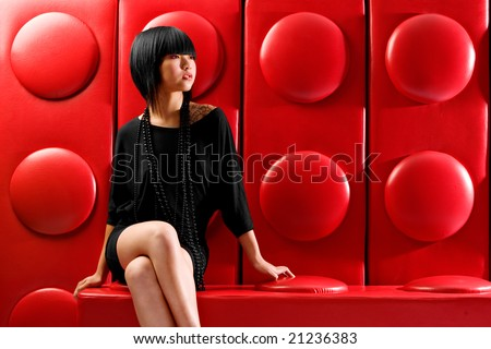 Asian fashion model on red background - stock photo