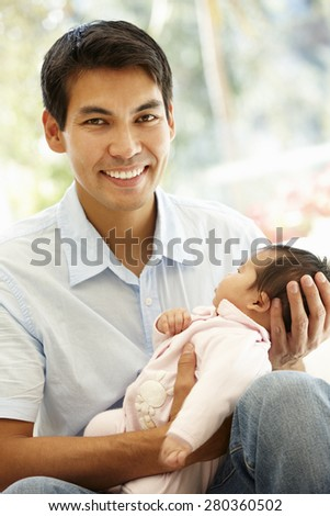 Asian father and baby - stock photo