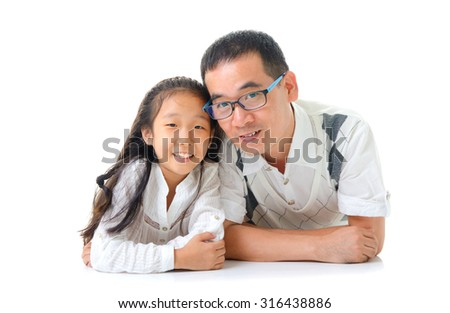 Asian father and daughter lying on the floor