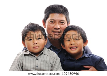 Asian father cuddles sons looking happy