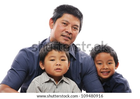 Asian father embraces his happy sons