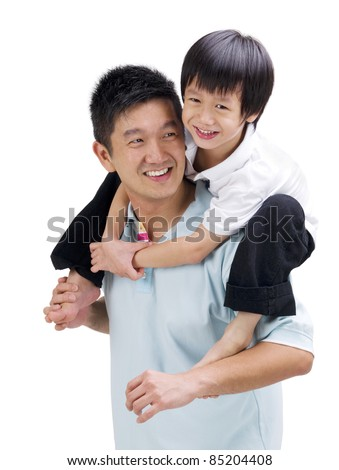 Asian father giving piggyback ride to his son - stock photo