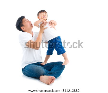 Asian father playing with baby boy - stock photo