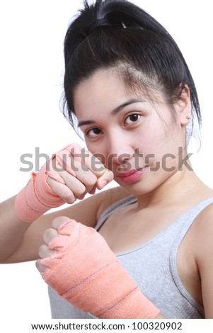 Asian female boxer in fighting stance.