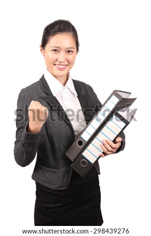 Asian female business executive holding file and showing success - stock photo