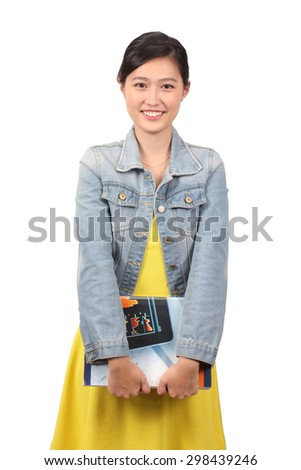 Asian female college student holding textbooks - stock photo