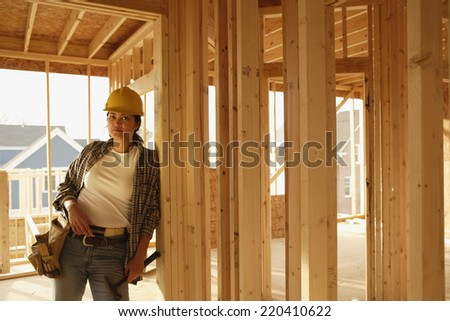 Asian female construction worker inside construction site - stock photo