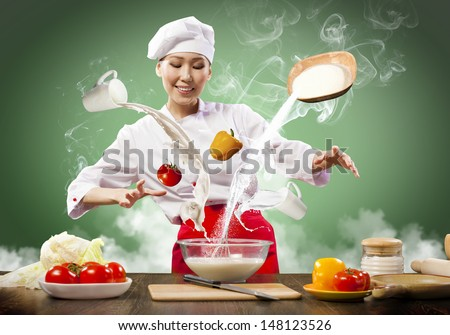 Asian female cooking with magic against color background - stock photo