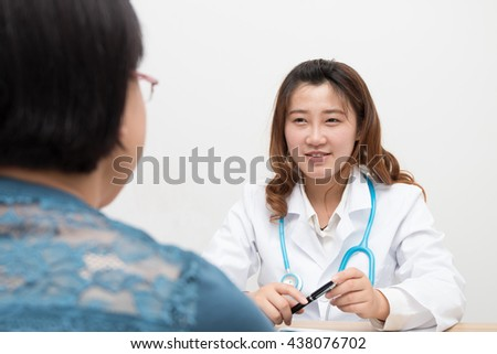 Asian Female doctor and patient - stock photo