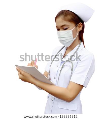 Asian female nurse writing medical report on white background - stock photo