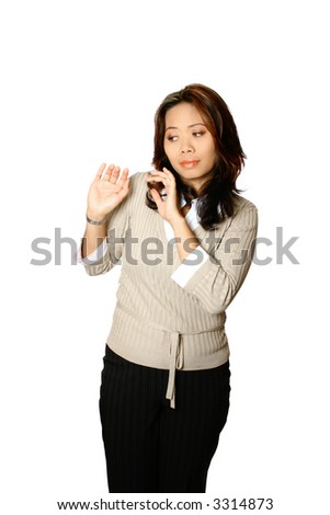 Asian female office worker showing fear, both hands in gesture of protecting herself from some kind of attack. Isolated on white background.