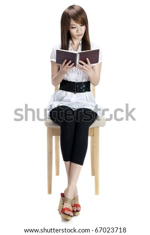Asian female Reading Book on Chair, Full Body Isolated on White. - stock photo