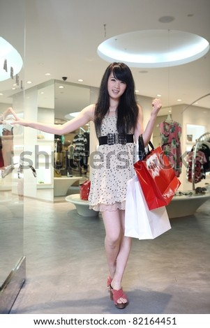 asian female shopping in mall - stock photo