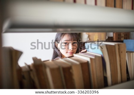asian female student in the library