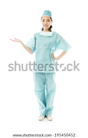 Asian female surgeon showing something - stock photo