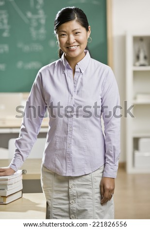 Asian female teacher in classroom