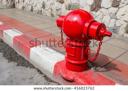 Asian fire hydrant on street. Typical red fire hydrant asian on street. Red fire Hydrant vintage style. - stock photo