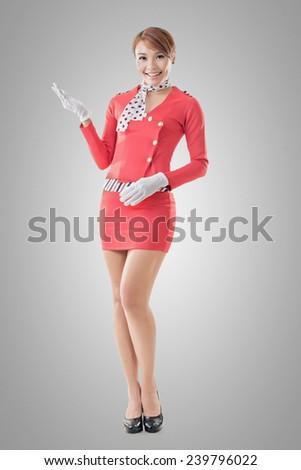 Asian flight attendant portrait, full length isolated. - stock photo