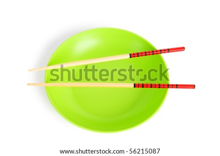Asian food concept with plate and chopsticks - stock photo