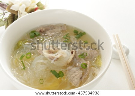 Asian food, pork and glass noodles with spring onion