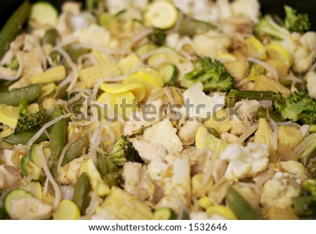 Asian Food: Stir-Fry with Chicken and Vegetables in a Wok. - stock photo