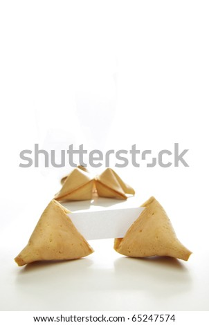 Asian fortune cookies with blank paper isolated on white background. - stock photo