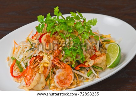 Asian fried rice noodles with shrimp and vegetables - stock photo