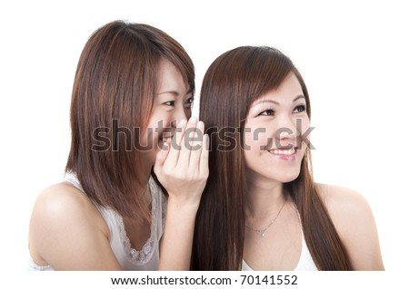 asian friends whispering to another - stock photo
