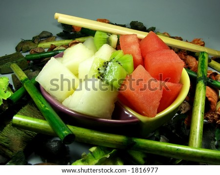 asian frutis tray whit flowers and bamboo
