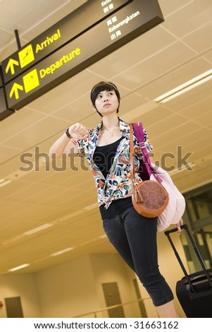 asian girl arriving at singapore's changi airport terminal